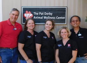 Pictured in front of the newly-installed Pat Derby Animal Wellness Center sign are (L-R): Ned Waters of Vet Rocket; PAWS Director of Veterinary Services Dr. Jackie Gai, DVM; PAWS part-time Associate Veterinarian Dr. Jennifer Curtis, DVM; PAWS Registered Veterinary Technician Lynn Dowling; and Andy Fu of Vet Rocket.